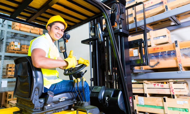 Forklift driver in warehouse with previous hand injury